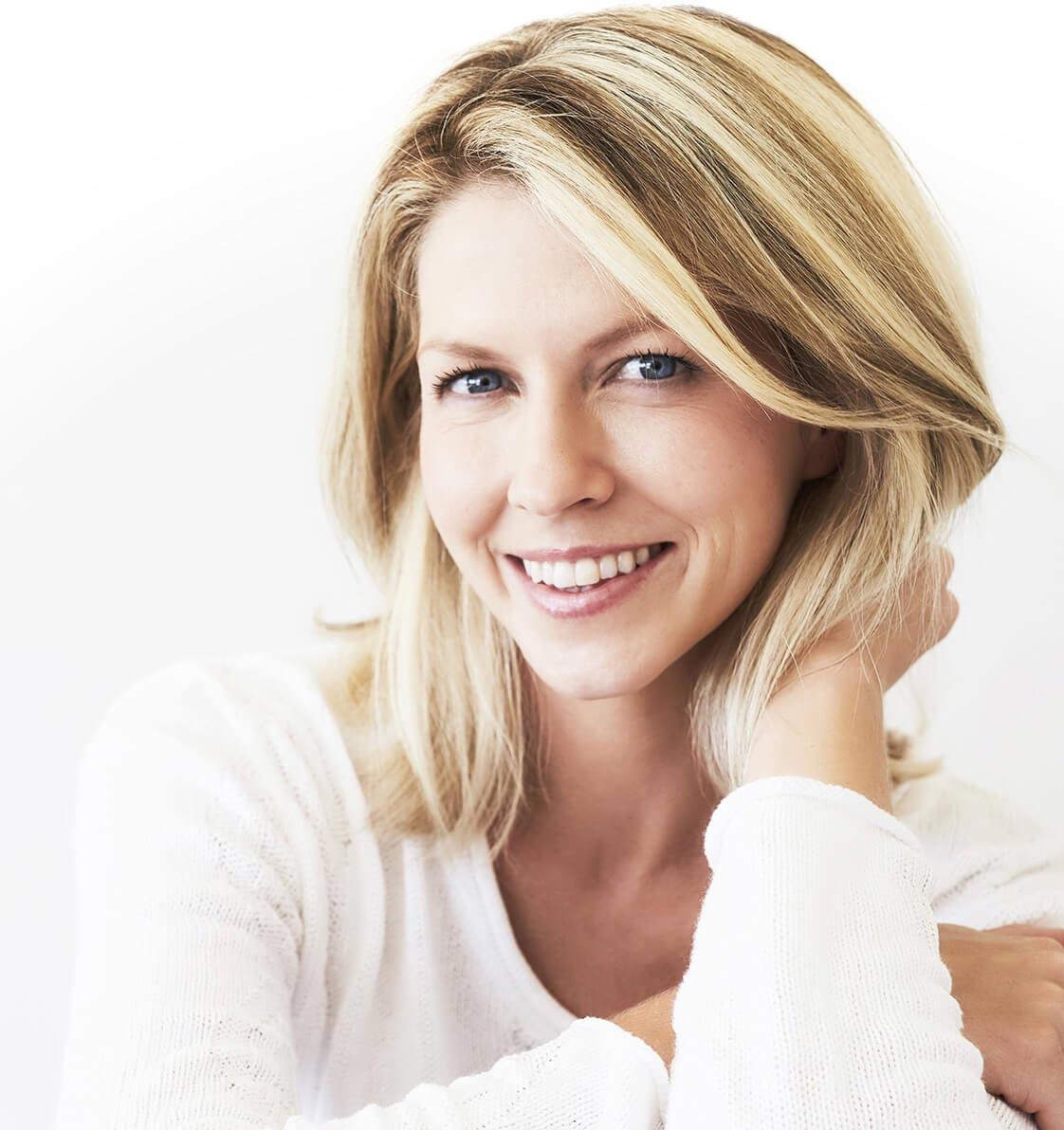 Praxisklinik Bartsch - Lächelnde Frau