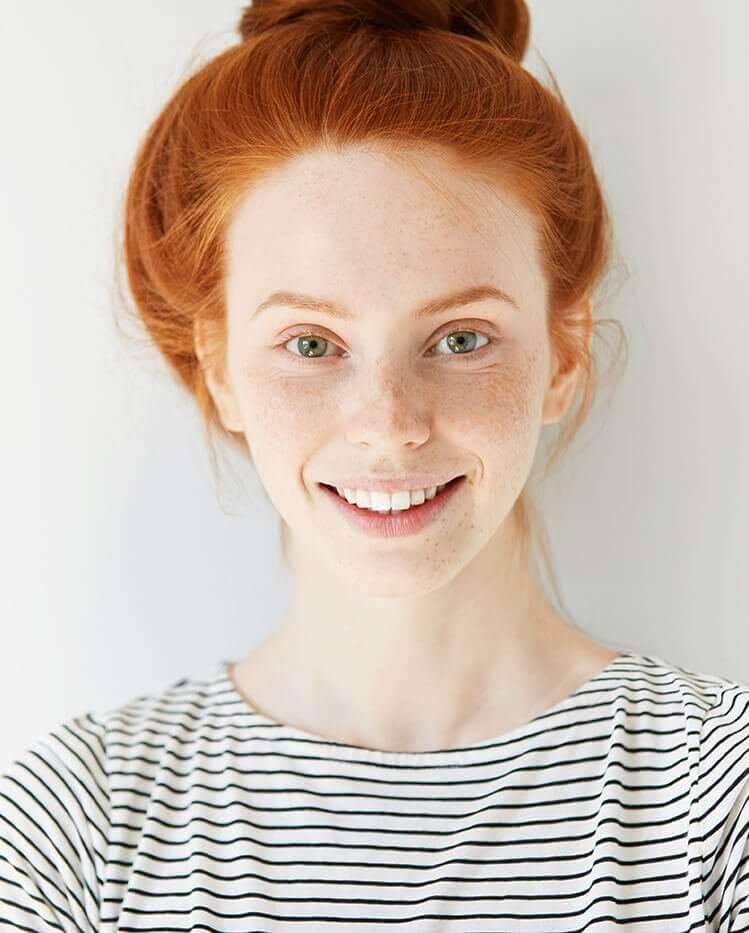Praxisklinik Bartsch - rothaariges Mädchen nach Zahnbehandlung